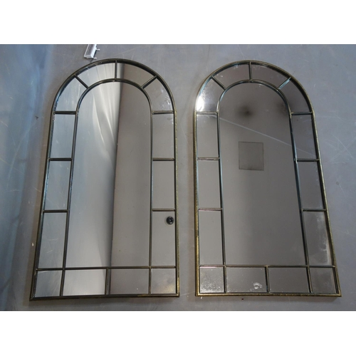 600 - A pair of arched top garden mirrors, 107 x 54cm...