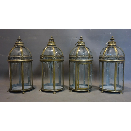 575 - A set of four gilt metal storm lanterns, H.48cm...