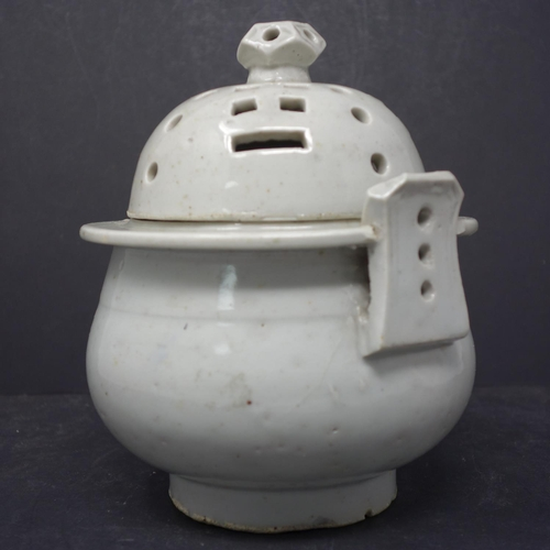 47 - A Korean white glazed porcelain censer & cover, the cover pierced with trigrams, H.28, diam. 15 cm...