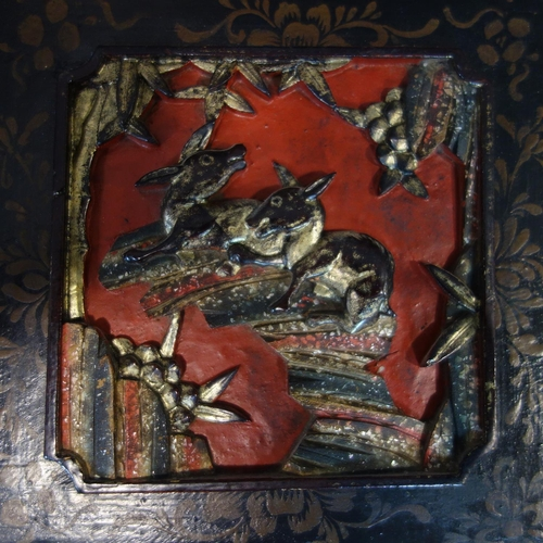 31 - A pair of Chinese carved wood panels in red lacquer with gilded window reveals, possibly from a room...
