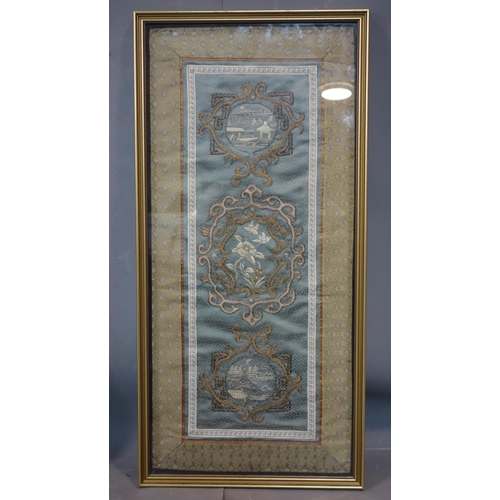 33 - A Chinese embroidered grey green silk panel of a central peony motif and two landscape motifs either...