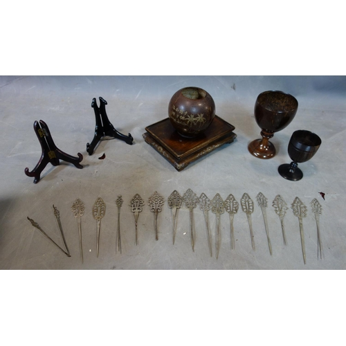 5 - A collection of white metal pins possibly Ethiopia, together with a group of miscellaneous wooden cu...