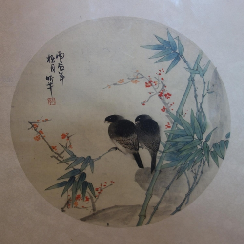 32 - Two Japanese paintings on silk, one depicting two birds sitting on a branch, signed and with seal ma...