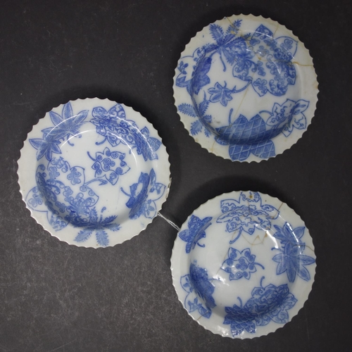 12 - Three Japanese porcelain saucers with blue and white leaf transfers, 115mm diameter, with four chara...