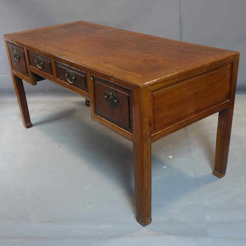 19 - A Chinese hardwood desk, with an arrangement of four drawers, raised on square legs, H.81 W.161 D.71...
