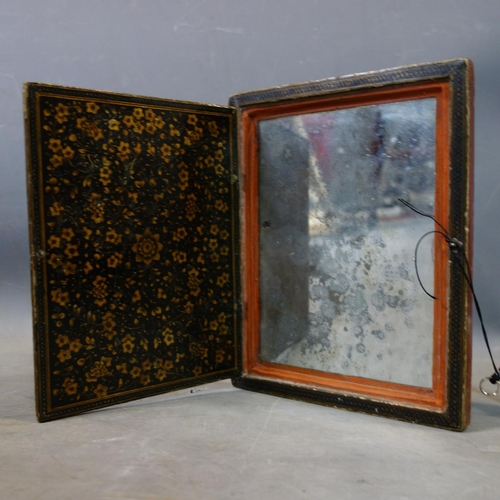 44 - A hand painted Persian mirror case, papier-mâché, gilded lacquered with original mirror inside, 18th...