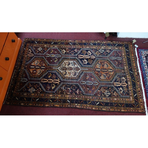 275 - A Southwest Persian Lori rug, repeating stylised geometric and petal motifs within stylised multi ge...