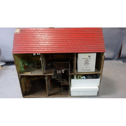 42 - A 1940's Tudor style vintage dolls house, together with furniture, H.65 W.78 W.31cm...