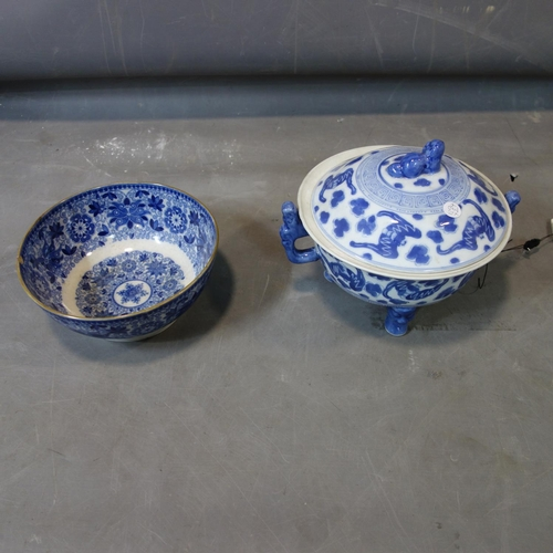 23 - A Chinese twin handled blue and white dish and cover, decorated with bats, within Greek key border, ...