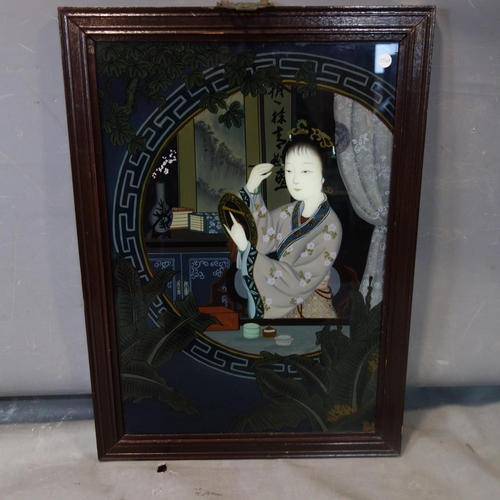 25 - A Chinese painting on glass of a lady applying makeup, within Greek key border, in hardwood frame, 6...