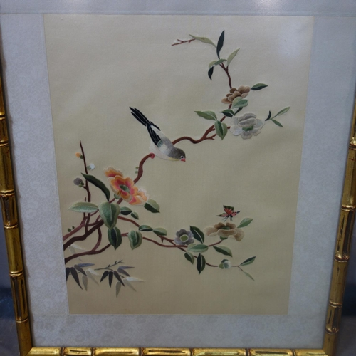 26 - A Chinese embroidery on silk of a bird on a blossoming branch, in gilt painted bamboo design frame, ...