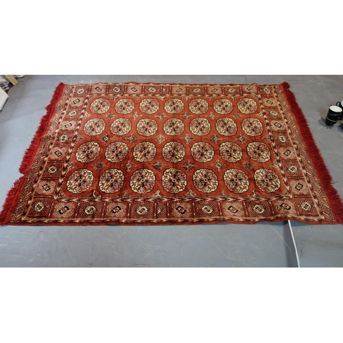 281 - A Persian Bokhara rug, repeating elephant pad motifs on a rouge field, 190 x 130cm...