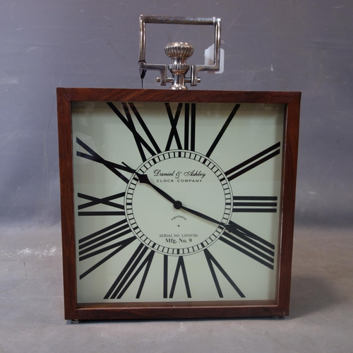 46 - A contemporary clock, the Roman dial signed Daniel & Ashley Clock Company, battery operated, H.52 W....