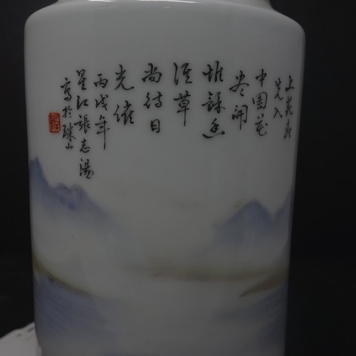 31 - A Chinese famille rose vase, decorated with a continuous lakescape with mountains to background, bea...