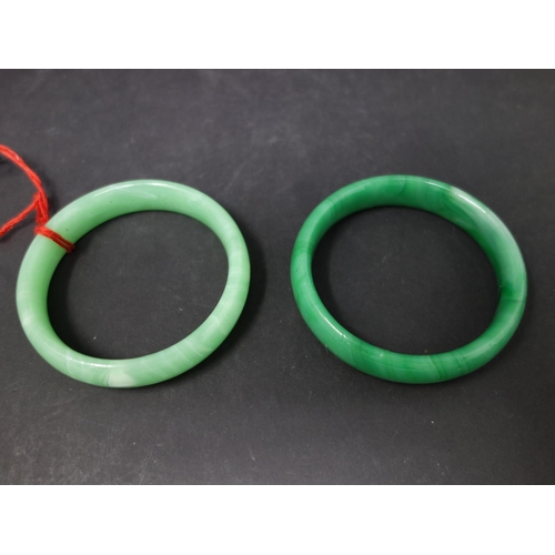560 - Two Chinese jadeite bangles...