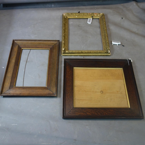 584 - Two oak Arts and Crafts frames and a gilt frame. Largest H.67 W.59cm