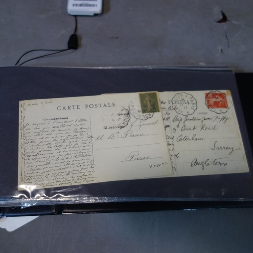 536 - A folder of miscellaneous postcards and stamps, including commemorative covers...