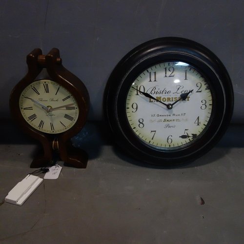 534 - Two battery operated clocks, to include a wall clock, Diameter 33cm, and a mantel clock with dial si...