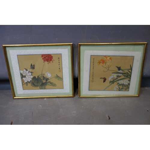 542 - Two Chinese paintings on silk of butterflies and flowers, bearing Chinese characters and red seal ma...