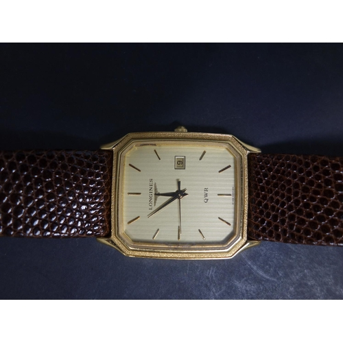 529 - A Longines QWR gold plated wristwatch, Quartz movement, the gilt dial with baton markers, date apert...