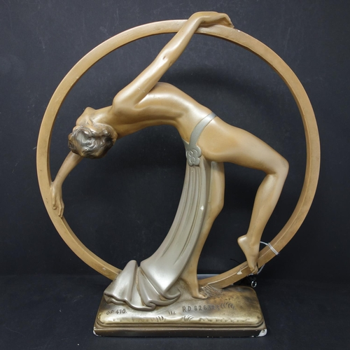 510 - An Art Deco plaster figure of dancing girl, bearing impressed marks OP. 410, RD. 826323 to base, H.3...