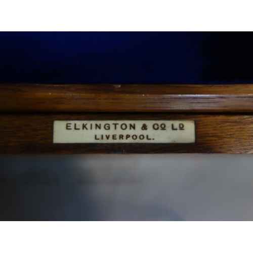 503 - An Elkington canteen of silver plated cutlery,  incomplete, in oak case, to include dessert spoons, ...