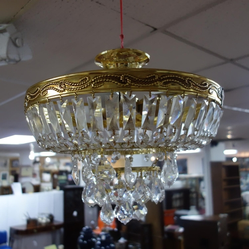 600 - A contemporary circular gilt chandelier, Diameter 37cm...