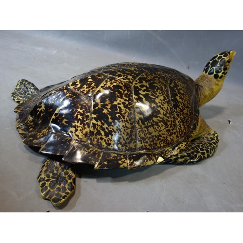 513 - A life size fibreglass model of a sea turtle, H.26 W.70 D.50cm...