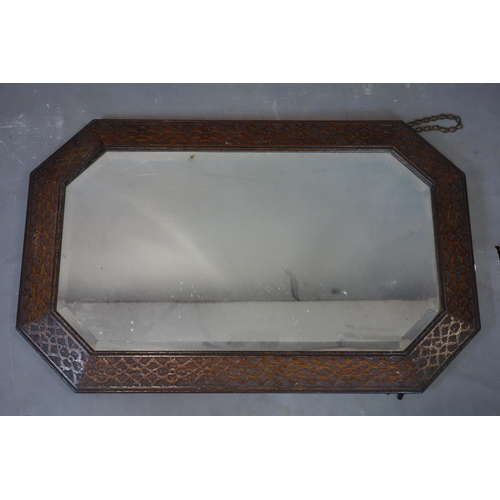 590 - An early 20th century oak mirror with bevelled plate, 82 x 52cm...