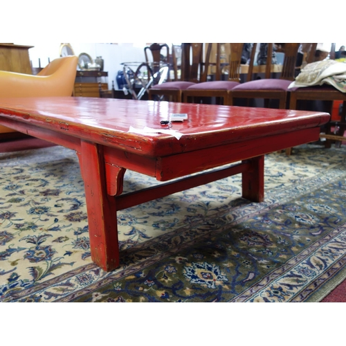 549 - A large 20th century Chinese red lacquered coffee table, H.40 W.213 D.79cm...