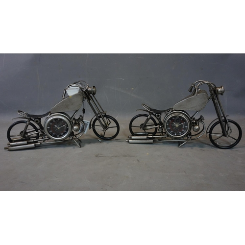 532 - A pair of contemporary desk clocks in the form of vintage motorbikes, each having two dials with Ara...