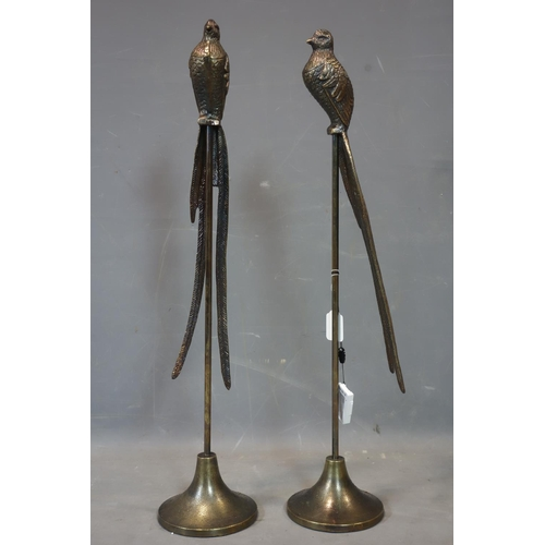 520 - A pair of bronzed birds on stands, H.82cm...