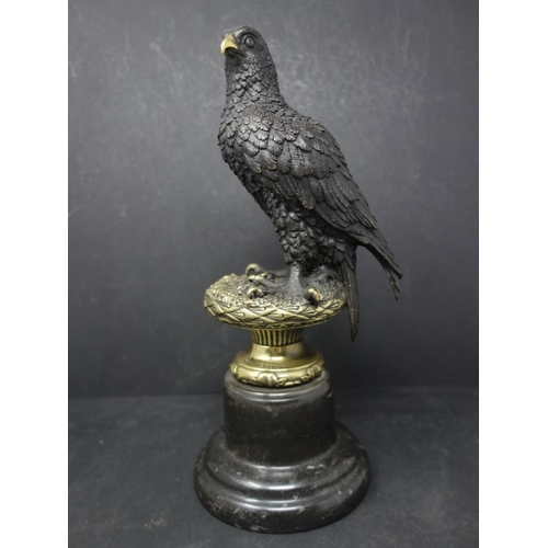 524 - A bronze study of an eagle on a naturalistic base, after A. Thorbum, bearing signature, raised on a ...
