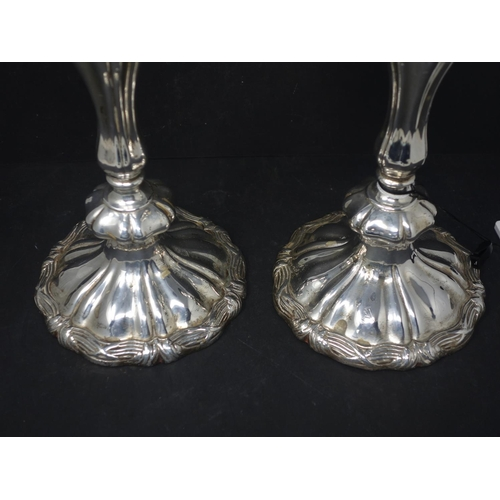 505 - A pair of 19th century silver plated candlesticks, with knopped stem on spreading base, H.30cm...