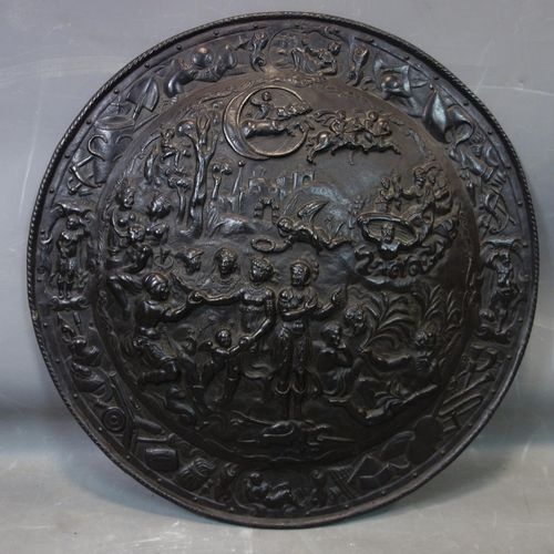 525 - An antique iron shield relief decorated with Romanesque scenes, D.58cm...