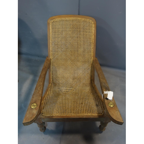 263 - A pair of 20th century teak armchairs, with caned seat and backrests, on turned legs, H.93 W.78cm, s...