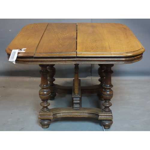 243 - A late 19th century oak extending dining table, raised on turned supports joined by stretchers, H.73...