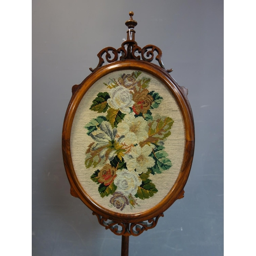 245 - A late 19th century mahogany stand with tapestry screen depicting flowers, on three carved feet, H.1...