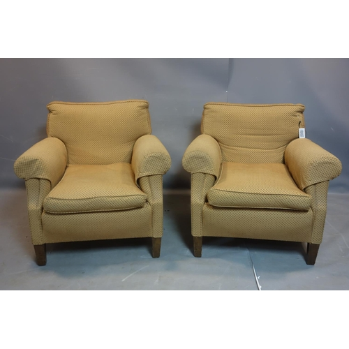 278 - A pair of armchairs with beige upholstery, raised on tapered oak feet...