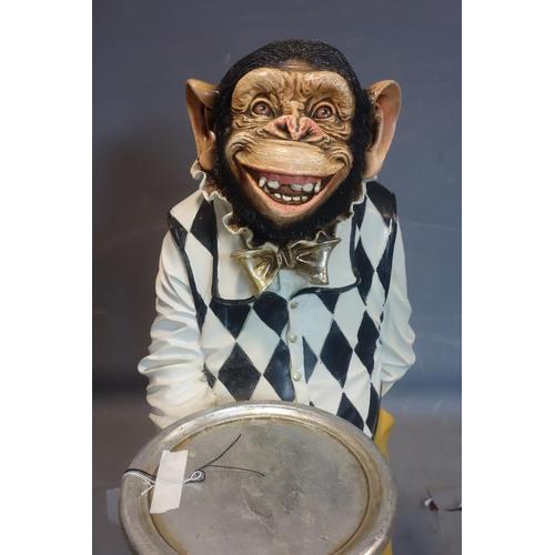 91 - A fiberglass chimpanzee dumb waiter, H.100cm...