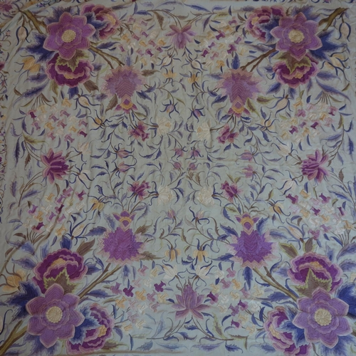 132 - A large collection of vintage lace to include an embroidered silk table cloth...