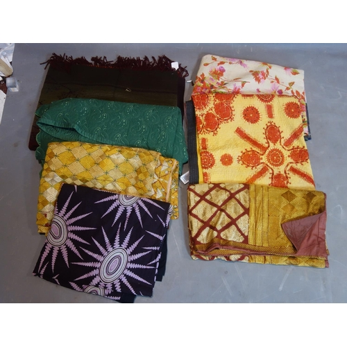 133 - A collection of 8 vintage textile wall hangings/throws...