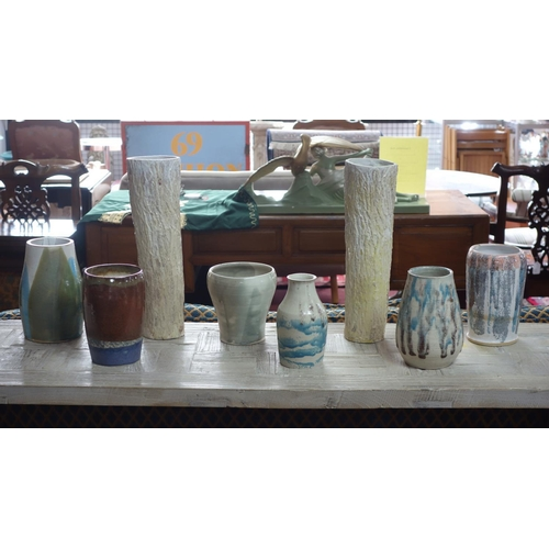 4 - A collection of 8  Studio Art Pottery vases of varying size and form (8)...