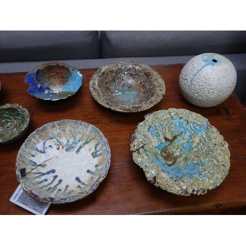 7 - A collection of  9 Studio Art Pottery bowls and dishes together with a Studio Art Pottery ovoid vase...