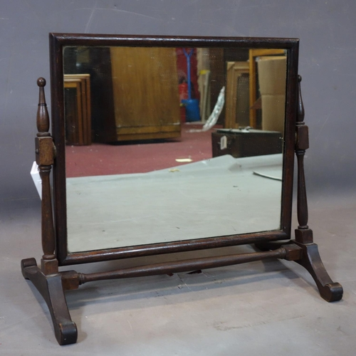 67 - An early 20th century oak vanity mirror, H.47 W.52 D.30cm...
