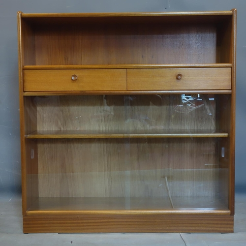 103 - A 20th century teak bookcase with 2 drawers and 2 sliding glass doors, label for Nathan, H.108 W.102...