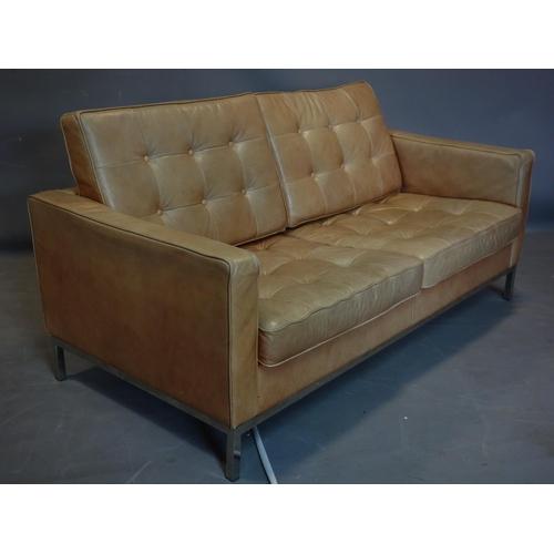 104 - A Florence Knoll style tan leather sofa, raised on chrome base...