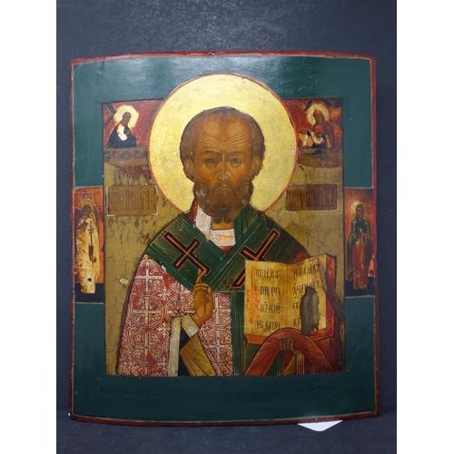 12 - A Russian icon of St Nicholas of Myra, tempera on wood panel, 36 x 31cm...
