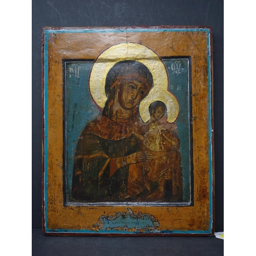16 - A Russian icon of the Mother of God, tempera on wood panel, inscribed to verso in Cyrillic, 31.5 x 2...