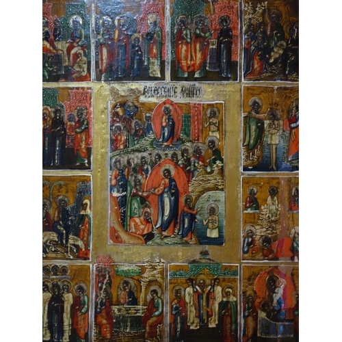 9 - A Russian icon of The Descent into Hell, The Resurrection and The Twelve Feasts, tempera on wood pan...